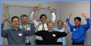 Workers celebrating a win - staff loyalty!